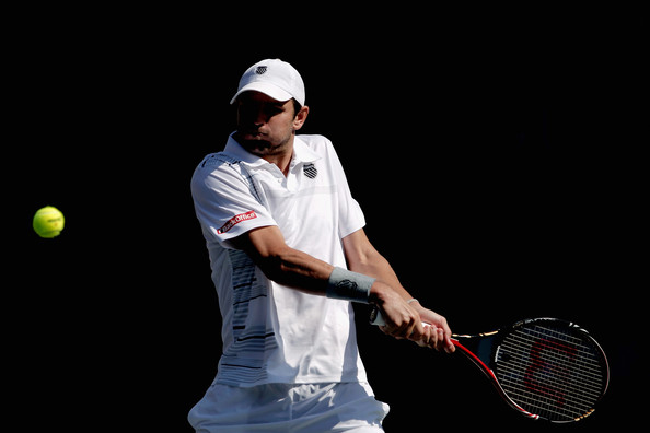 Mardy Fish of the United States plays a backhard in his quarter final match against Bernard Tomic of Australia during day five of the Rakuten Open at Ariake Colosseum on October 7, 2011 in Tokyo, Japan.